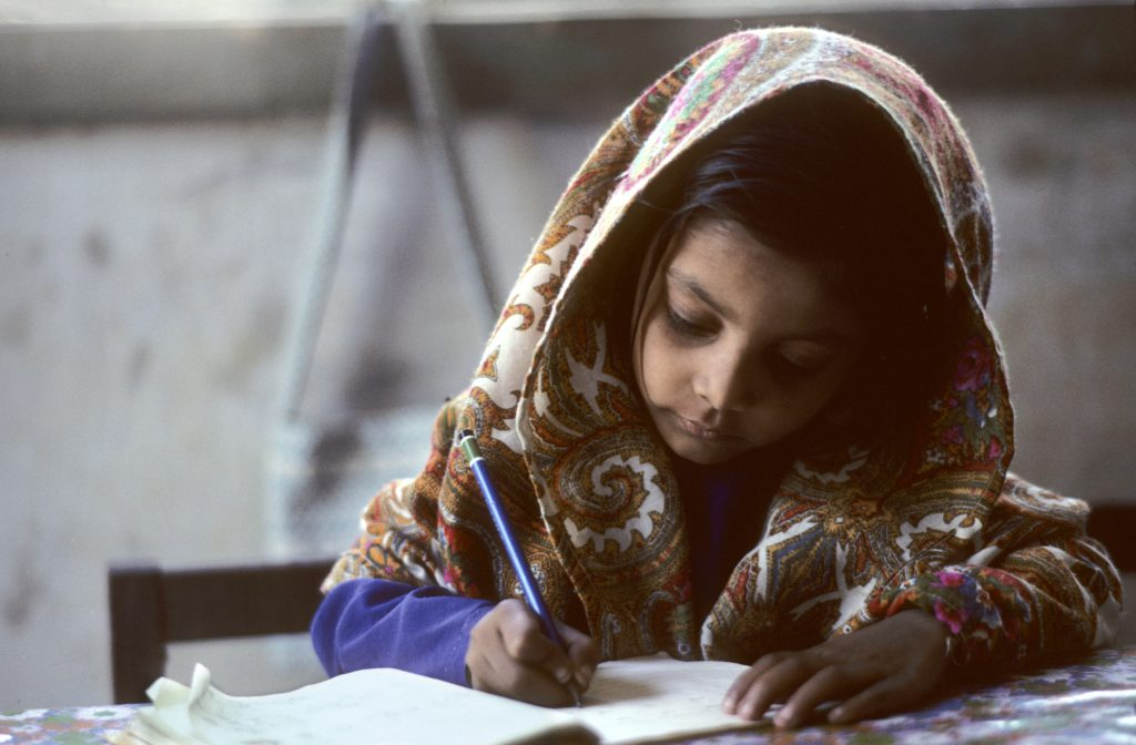 Portrait of Pakistani Schoolgirl by UN Photo/John Isaac is licensed under CC BY-NC 2.0